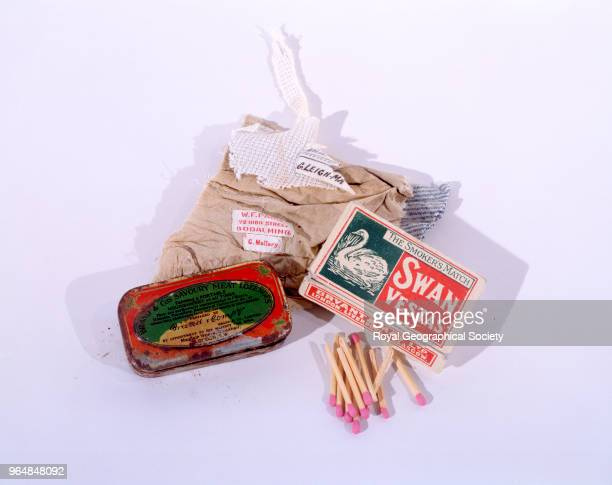 Cloth fragment with two labels matchbox with matches and a tin of meat lozenges George Mallory and Andrew Irvine disappeared en route to the summit...