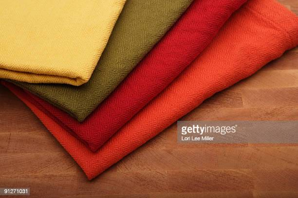cloth napkins on cutting board - lori lee stock pictures, royalty-free photos & images