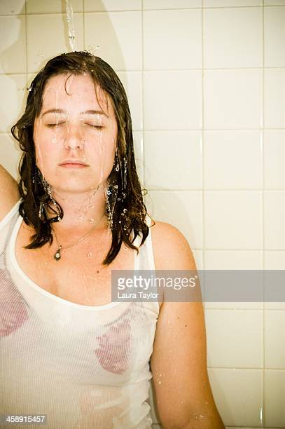 clothed woman in shower