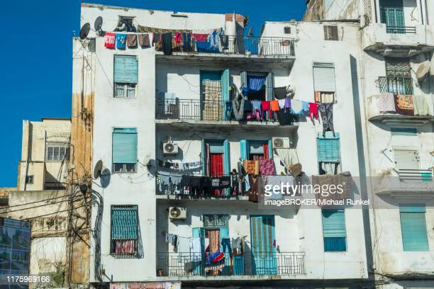 clothelines on balconies, house fassade, oran, algeria - oran algeria photos et images de collection