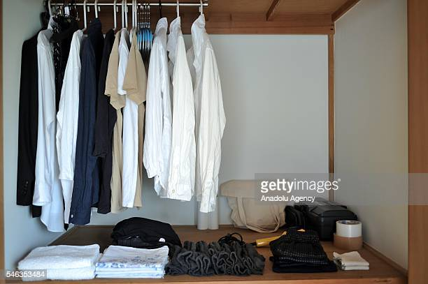 Clothes and bags are seen in the wardrobe at the minimalist Katsuya Toyodas apartment in Tokyo Japan on July 02 2016 Katsuya Toyoda an online...