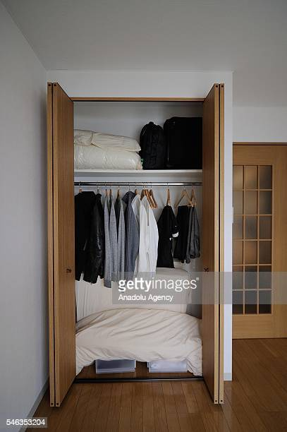 Clothes and futon mattress are seen in the small laundry room of minimalist Fumio Sasakis apartment in Tokyo Japan on June 24 2016 Fumio Sasaki...