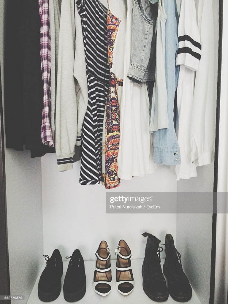 Clothes And Shoes Arranged In Closet : Stock Photo