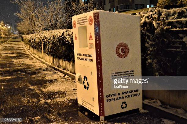 A clothes and shoes drop off box is seen as it is placed by a progovernment NGO to support the government's measures in order to boost the economy in...