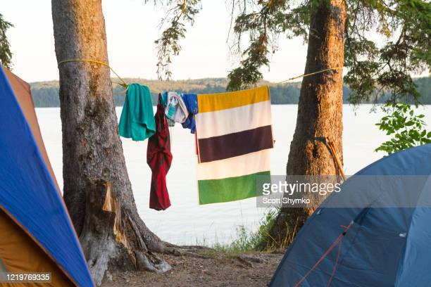 clothes and towel hang to dry by tents - towel stock pictures, royalty-free photos & images