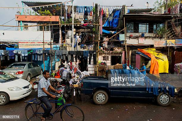 Clothes are drying on a car outside an openair laundromat near Cuffe Parade in South Mumbai