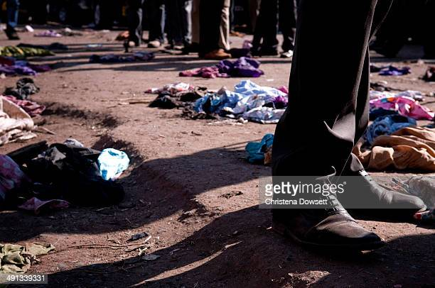 Clothes are scattered on the ground after two improvised explosive devices went off in Gikomba market on May 16 2014 in Nairobi Kenya Two improvised...