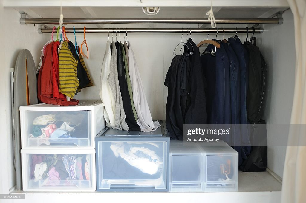 Clothes are seen in in a wardrobe at the Minimalist Naoki Numahatas home in Tokyo, Japan, on July 02, 2016. Naoki Numahata, 41, a freelance writer who lives with his wife and their daughter, decided to live less cluttered with useless personal and domestic possessions during a travel and after meeting a family who live quite simply in Croatia. This philosophy 'Minimalism' has become famous in recent years in Japan especially between young people who want nothing to do with acquiring material possessions, but would rather spend their money, time, and effort on things that they truly enjoy. Minimalism is a different style that uses pared-down design elements. Minimalism in the arts began in postWorld War II Western art, most strongly with American visual arts in the 1960s and early 1970s.