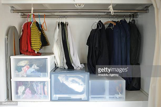 Clothes are seen in in a wardrobe at the Minimalist Naoki Numahatas home in Tokyo Japan on July 02 2016 Naoki Numahata a freelance writer who lives...