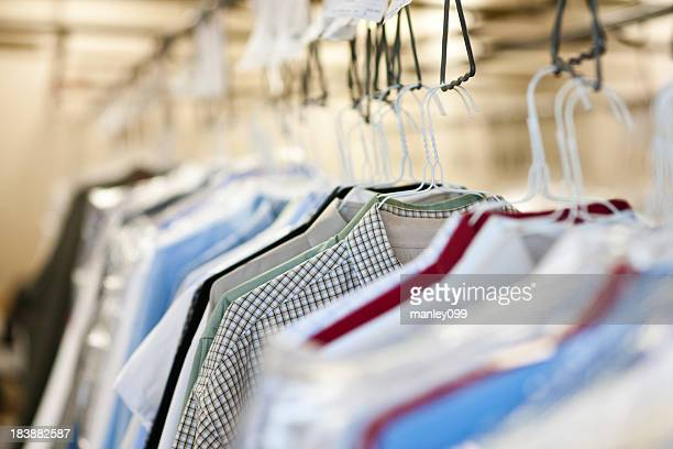 clothes at a dry cleaners - dry cleaner stock pictures, royalty-free photos & images