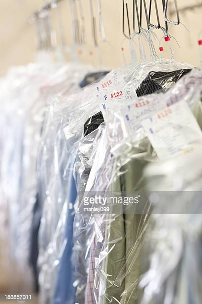 clothes at the dry cleaners finished - dry cleaner stock pictures, royalty-free photos & images