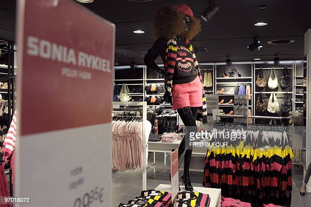 Clothes designed by redhaired 79yearold French designer Sonia Rykiel for HM are displayed in a HM store stocking her new collection on February 20...