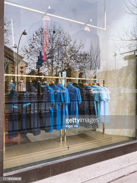 clothes displayed in the window - store window stock pictures, royalty-free photos & images