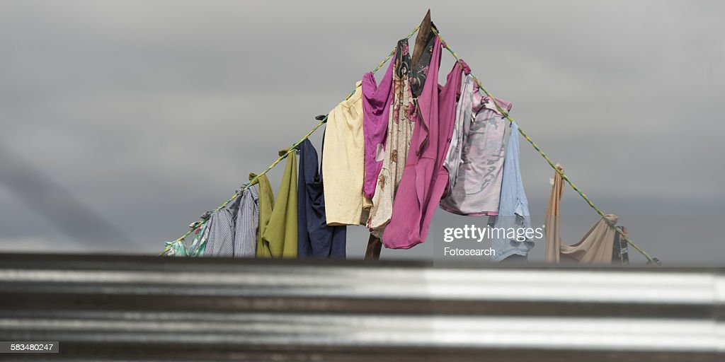 Clothes drying on a clothesline : Stock Photo