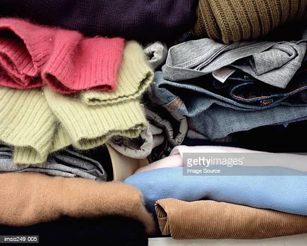 clothes folded in cupboard - いっぱいになる ストックフォトと画像