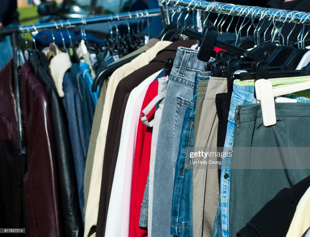Clothes for sale at car boot sale : Stock Photo
