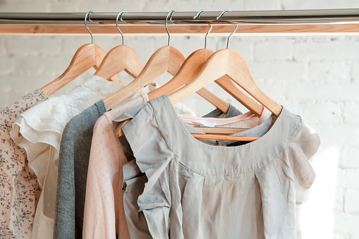 Clothes hang on clothing rack 671217220