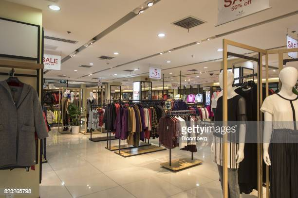 Clothes hang on display inside the Bosideng International Holdings Ltd. Flagship clothing store in Shanghai, China, on Friday, July 14, 2017....