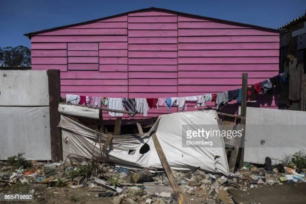 Clothes hang outside a home near the defunct gramacho landfill in the Jardim Gramacho neighborhood of Duque de Caxias Rio de Janeiro State Brazil on...