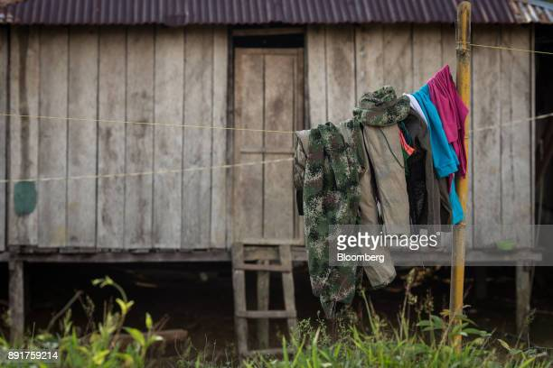 Clothes hang outside to dry at the home of a National Liberation Army guerrilla in a remote village in Choco Department Colombia on Friday Nov 17...