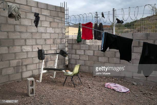 Clothes hang to dry at an immigrant shelter on May 09 2019 in Sonoyta Mexico The number of families mostly from Central America seeking asylum in the...