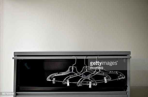 Clothes hangers hang from an empty file cabinet inside an office on a floor once occupied by Cathay Financial LLP inside 777 Third Avenue a building...