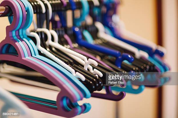 Clothes hangers on rail