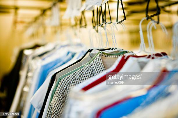 clothes hanging at dry cleaners - dry cleaner stock pictures, royalty-free photos & images