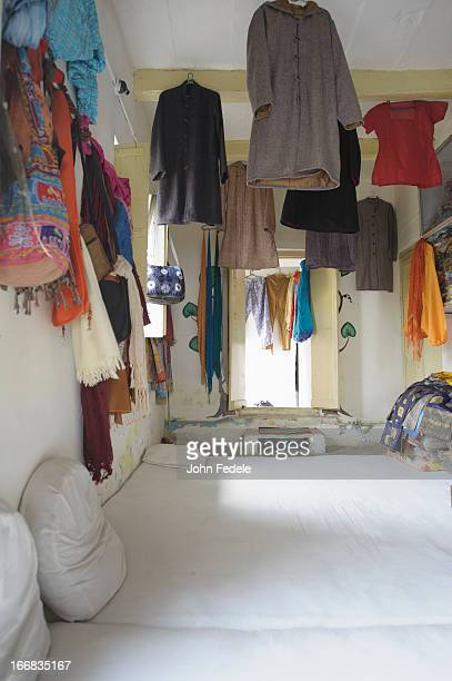 Clothes hanging from ceiling and walls
