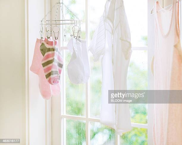 Clothes Hanging From Small Rack