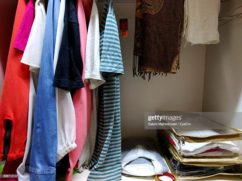 Clothes Hanging In Closet At Home : Stock Photo