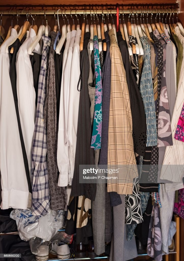 Clothes Hanging In Closet : Stock Photo