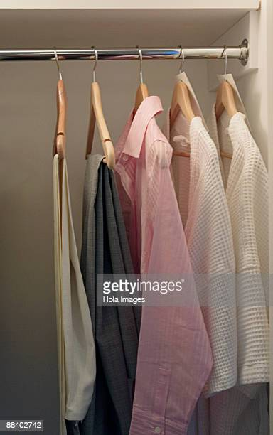 Clothes hanging in hotel room closet