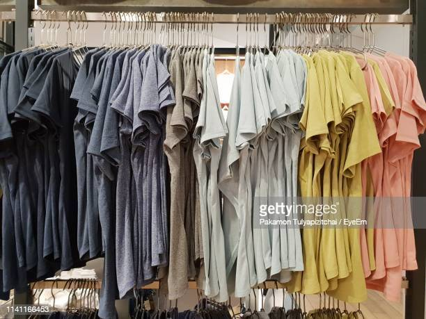 clothes hanging in store - clothes rack stock pictures, royalty-free photos & images