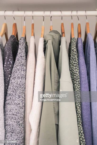 clothes hanging in the wardrobe - fashion collection stock pictures, royalty-free photos & images