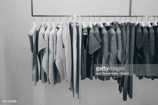 clothes hanging on coathanger in store - coathanger stock pictures, royalty-free photos & images