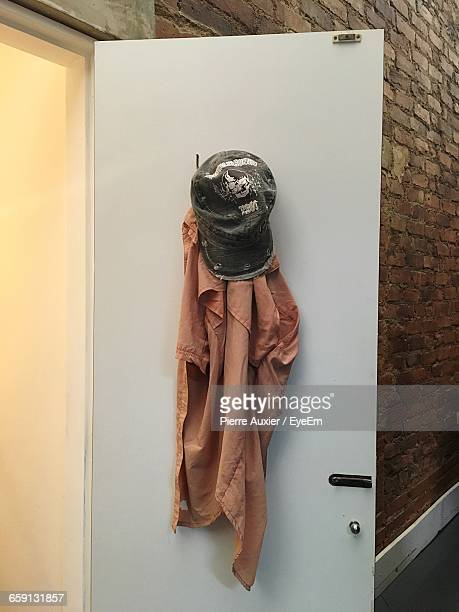 clothes hanging on door - baseball cap stock pictures, royalty-free photos & images