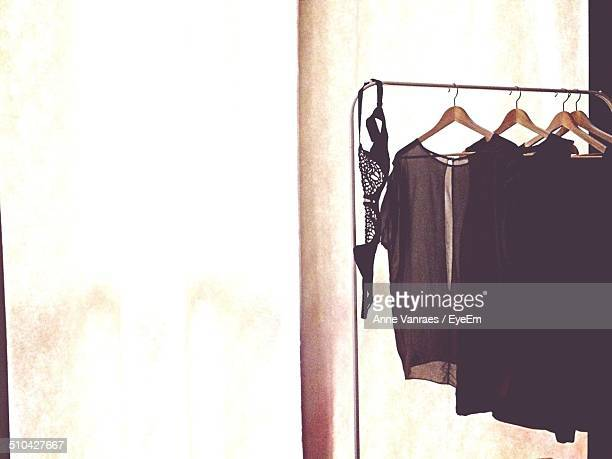 Clothes hanging on rail against white background