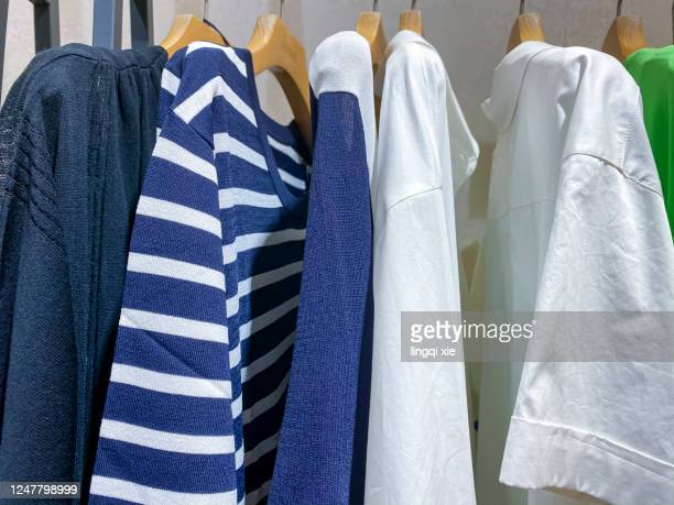 clothes hanging on the shelf - shirt stock pictures, royalty-free photos & images