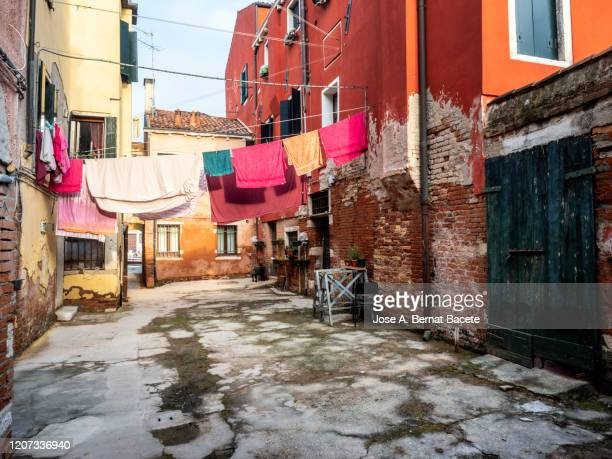 clothes hanging on the streets of venice. - nationell sevärdhet bildbanksfoton och bilder