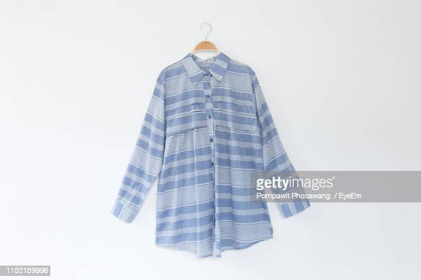 clothes hanging on white background - blue blouse stock pictures, royalty-free photos & images