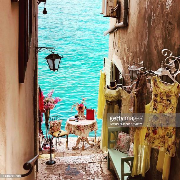 clothes hanging outside house building by sea - croatia stock pictures, royalty-free photos & images