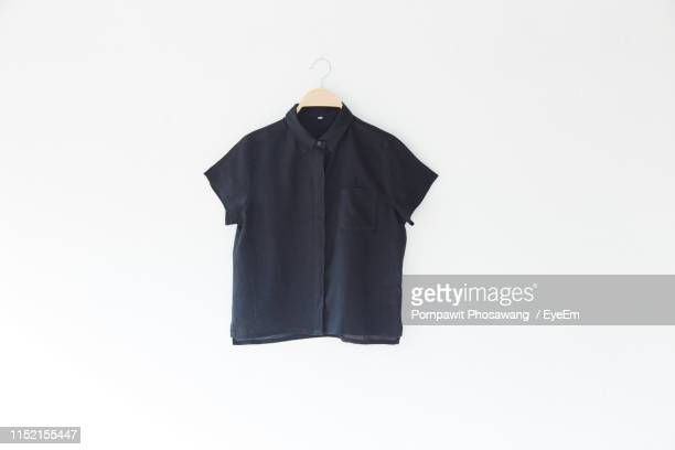 clothes hanging over white background - menswear photos et images de collection