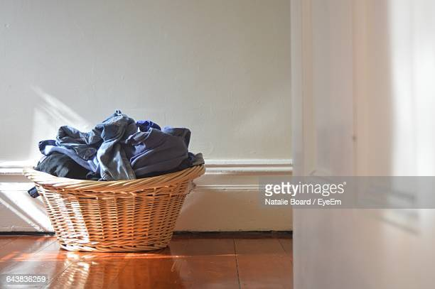 Clothes In Basket Against Wall At Home