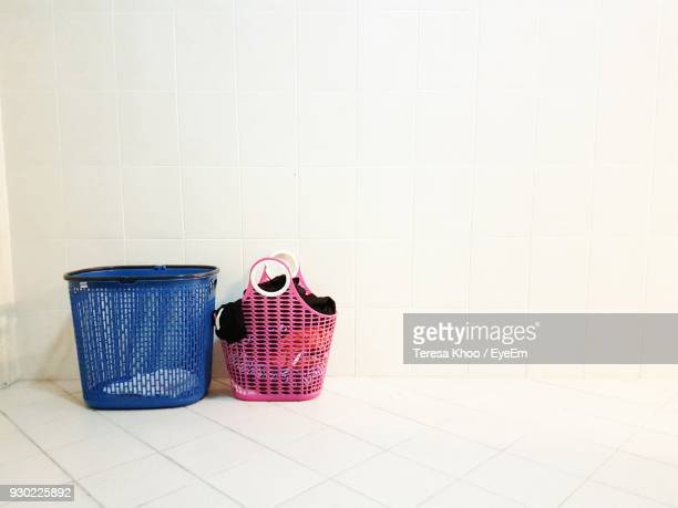 Clothes In Basket On Tiled Floor At Home