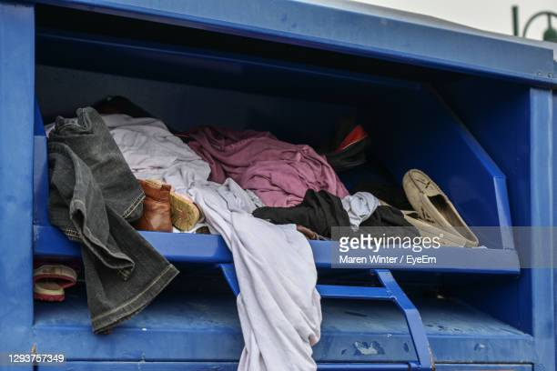 clothes in container - rubbish bin stock pictures, royalty-free photos & images