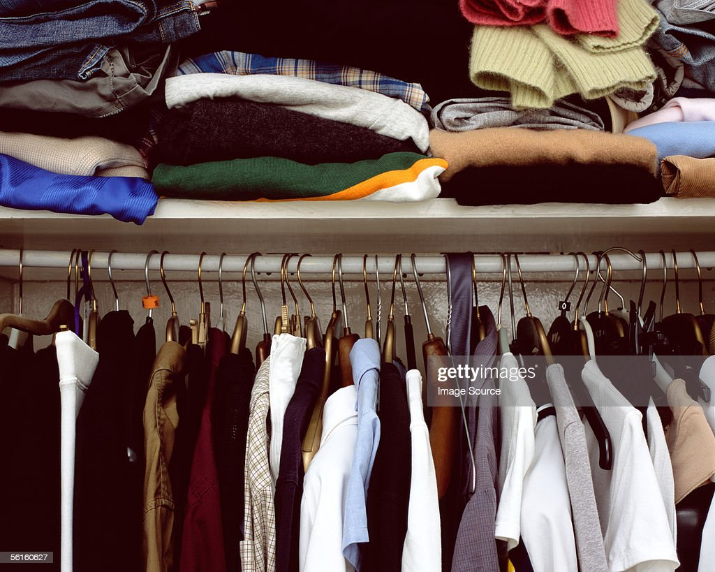 Clothes in cupboard : Stock Photo