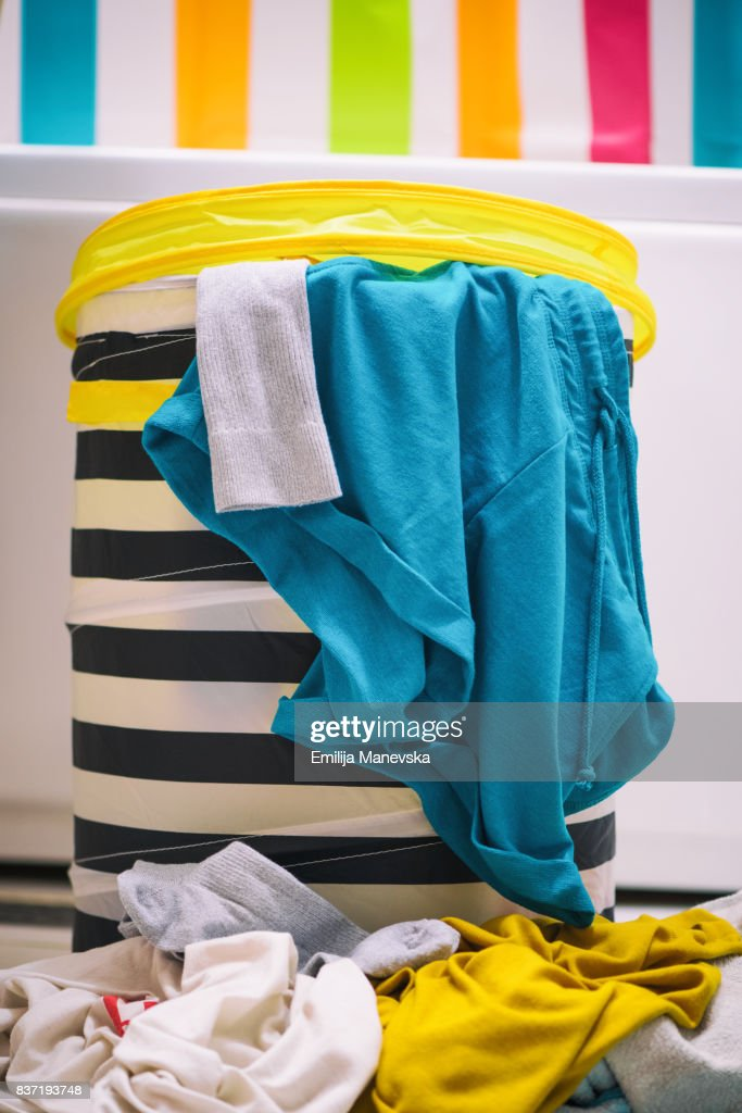 Clothes in laundry basket : Stock Photo