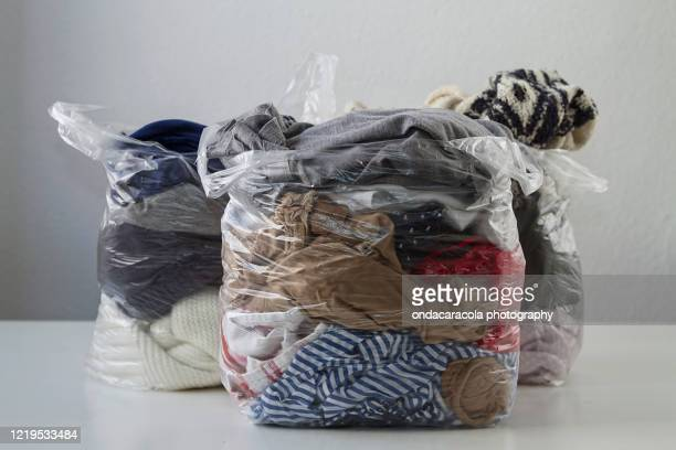 clothes in plastic bags - clothing stock pictures, royalty-free photos & images