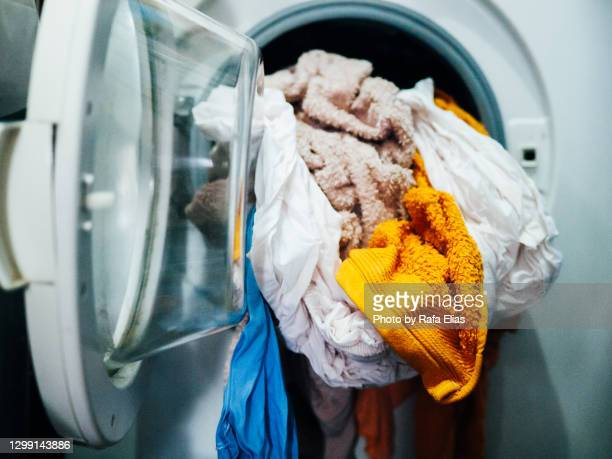 clothes in the washng machine - washing machine stock pictures, royalty-free photos & images